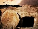 Jesus' empty tomb with rolled stone and 3 crosses in the background